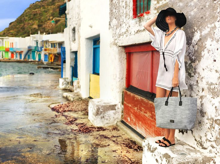 While a Greek island is a stunning colourful backdrop, the simplicity of this black and white styling is fresh, clean and sophisticated <3 #achilleasaccessoriesaustralia