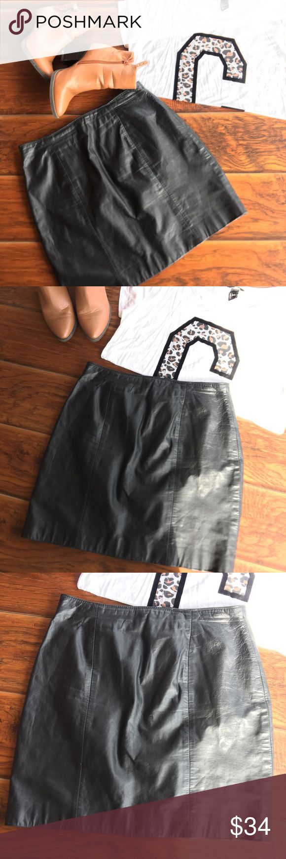 """Wilson's  Leather Black Mini Skirt. Wilson's Leather Black Mini Skirt •Sz: 12 •100% Leather •Pre-owned Good  condition. •zipper in the back part  Approx. measurements laying flat down and in inches: Waist: 15"""" Length: 17.5"""" Leg opening:19"""" Wilsons Leather Skirts Mini"""