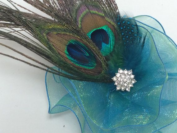 Turquoise Peacock Feather Magnetic Brooch by VintageBloomsByEllen on Etsy. This would make an elegant peacock wedding corsage.