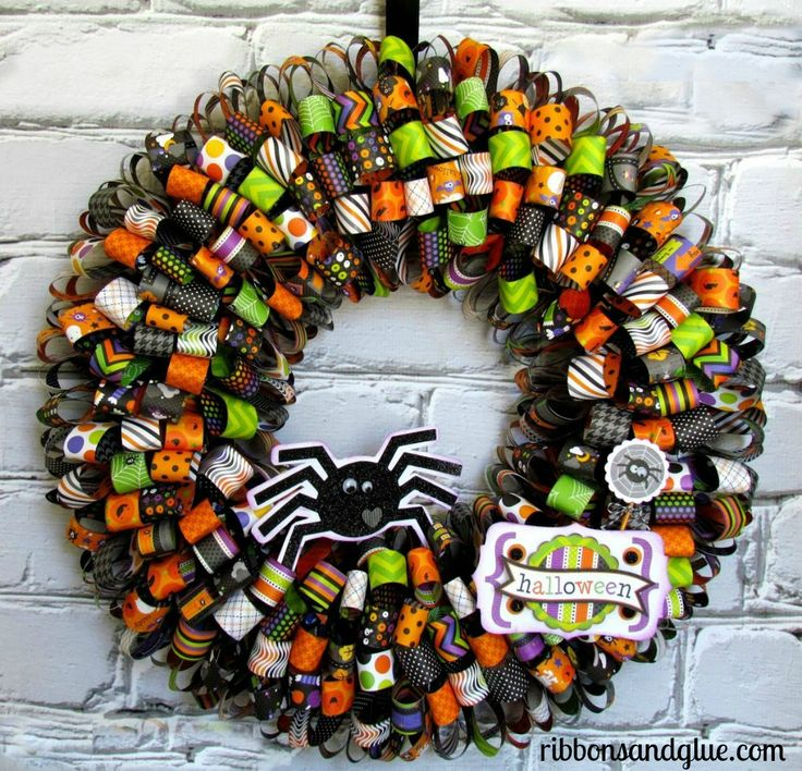 Halloween Paper Ribbon Wreath made with paper ribbons hot glued on to a wreath form embellished with Silhouette die cuts. Gorgeous Halloween Wreath