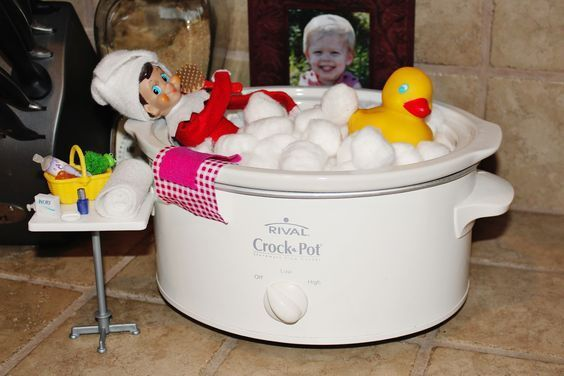 Scrub a dub dub, there's an elf in that crock pot tub! How ADORABLE is this Elf on the Shelf idea?