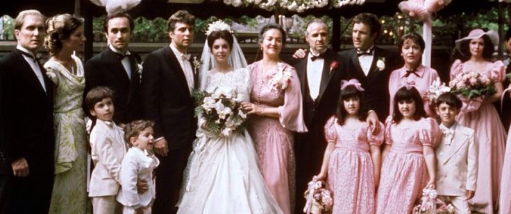 "THE GODFATHER MARRIAGE SCENE~ The Corleone family at the wedding of Constanza Corleone and Carlo Rizzi. From L to R: Tom Hagen, (adopted son and consigliere), his wife Theresa, Alfredo (Fredo) the youngest son, the bridegroom, Carlo Rizzi, the bride Connie Corleone, Mama Corleone. Don Vito Corleone, Santino ""Sonny"" Corleone, the eldest son, and his wife, Sandra. Sonny's mistress, Lucy Mancini, the mother of his illegitimate son, Vincent Corleone"