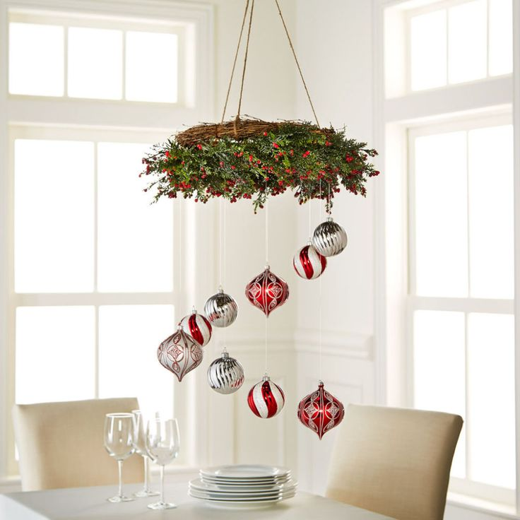 Hang ornaments from a wreath to create this unusual holiday decor chandelier