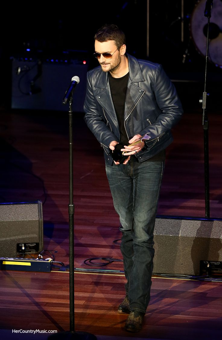 Eric Church receiving award. Eric Church tour dates, cities and discount ticket code at HerCountryMusic.com