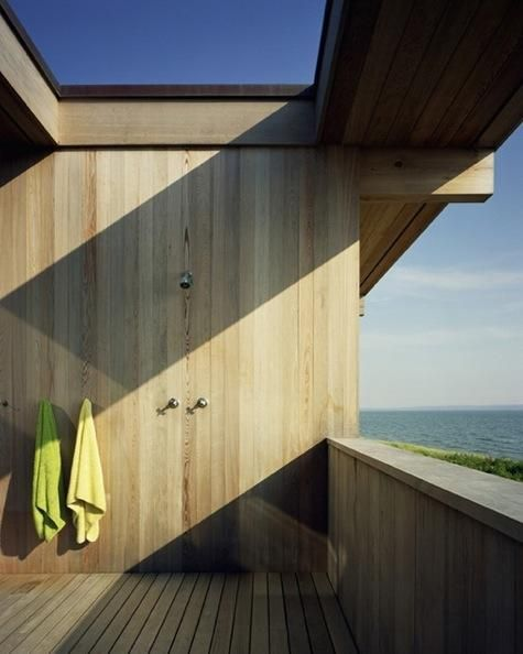 Great wooden outdoor shower with a superb view on the sea. #shower #wood #outdoor #nature #modern