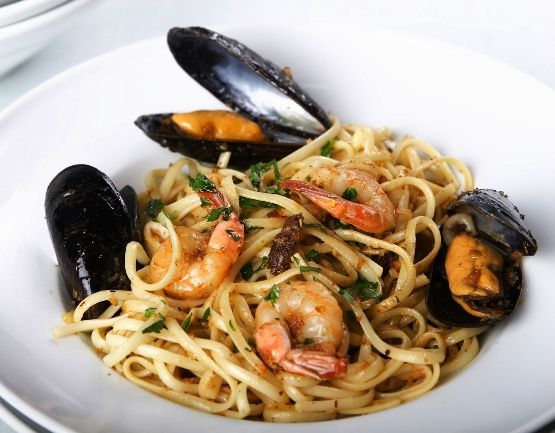 1lb Pasta (I used linguine, but any kind will work)  1 lb Shrimp, peeled and de-veined  2 lbs Mussels  4 tablespoons Olive Oil  4 tablespoons Butter  6 cloves of Garlic  ½ an Onion, chopped fine  1 cups White Wine  ¼ cup Lemon Juice  ¼ teaspoon Salt, or to taste  Parmesan Cheese  Fresh Parsley