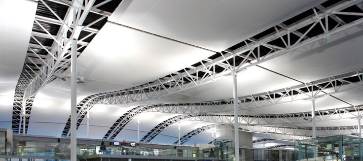 Airport • Brest, France | Architect: DRLW | large span acoustic tensioned ceiling made with Batyline membrane by Serge Ferrari