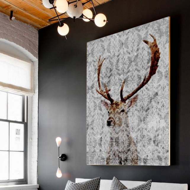 A stunning piece of ready to hang art. There's something so very magical about the look of a stag and the artist has captured its beauty to stunning results in this piece. The background features a subtle grey watermark design making it an easy piece to work into various interior styles. The piece is perfect for adding a striking focal point to your dining room or above your master bed or fireplace. Team with white walls, clean lines and high gloss furniture for a touch of Scandinavian ...