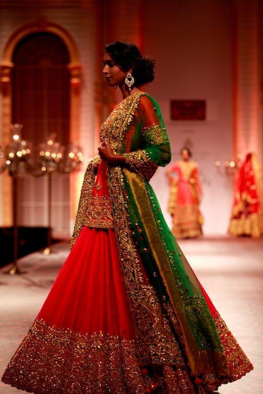 "Model walking on the ramp showcasing Preeti S Kapoor's ""Royal India"" bridal collection at the Amby Valley India Bridal Fashion Week."
