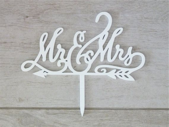 Mr & Mrs with Arrow Wooden Wedding Cake Toppers will make a great addition to any wedding cake. Available in a rustic wooden finish or one of 25 colours from my colour chart.  I HAVE AVAILABLE WHITE AND RAW CAKE TOPPERS THAT ARE AVAILABLE FOR NEXT DAY DISPATCH. Any other colours will take 1-2 weeks.  Wanting a little extra sparkle on you wedding cake. These wooden cake toppers come in White, silver and Gold glitter.  This listing is for 1 wooden cake topper of your colour choice. Dimensio...