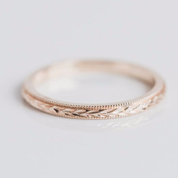 A textured stackable band with subtle details. Perfect with any stack, this engraved ring elevates every look with hand finished details. This 2mm 14kt gold band is hand engraved with a wheat pattern
