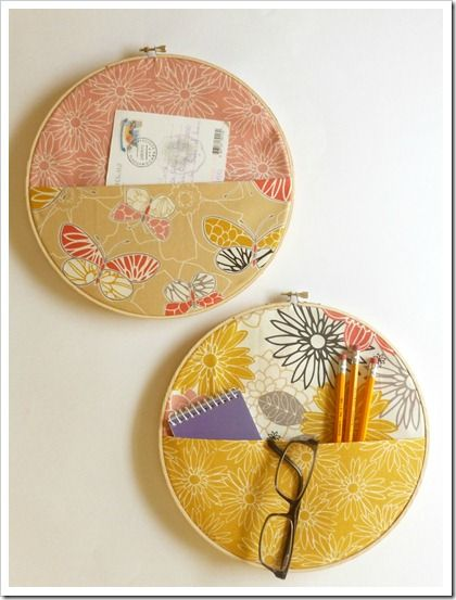 Oooh. A great way to organize mail/office supplies! DIY fabric wall pockets using embroidery hoops