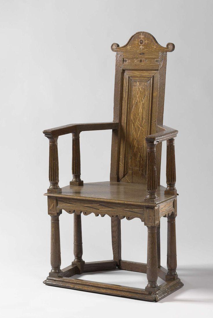 Anonymous | Armchair, Anonymous, c. 1560 - c. 1570 | Armstoel van eikenhout. Het meubel heeft een rechthoekige zitting en rust op zes poten. De poten worden onderaan door regels verbonden. De voorste en de middelste poten hebben de vorm van Toscaanse colonnetten. De armleggerstutten hebben de vorm van gecanneleerde Toscaanse colonnetten. De langwerpige rugleuning heeft een halfronde in voluten eindigende bekroning. De rugleuning, regels, huizen en de rugbekroning hebben inlegwerk van…