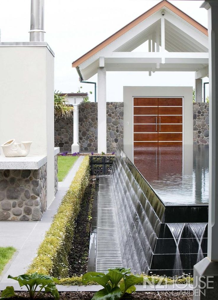 A surrounding moat planted with a living wall of fragrant flowers is a beautiful but practical safety barrier that neatly meets the pool safety code without the need for a fence.