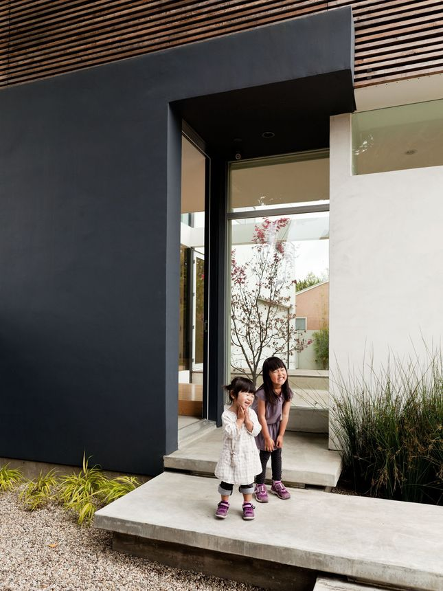 | ENTRY | lovely way to frame the entry with the use of bold colour blocking paired with wood slatting & polished concrete. Plus these 2 little girls are just adorable. Photo Credit: Unknown, if you know the original source, please let me know so I can include appropriate credit. #entry #exterior