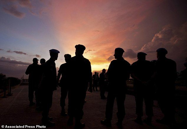 Silhouettes of U.N. peacekeepers from Brazil at the airport in Port-au-Prince, Haiti.