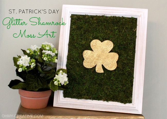 St. Patrick's Day Glitter Shamrock Moss Art - Create a easy St. Patrick's Day piece of art to use to decorate your home! Perfect for Spring!