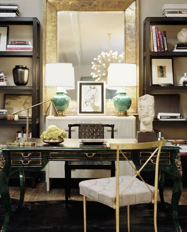 Kelly Wearstler    Gold & celadon green chic office design. Love the large gold leaf mirror which is flanked by two large black bookcases!