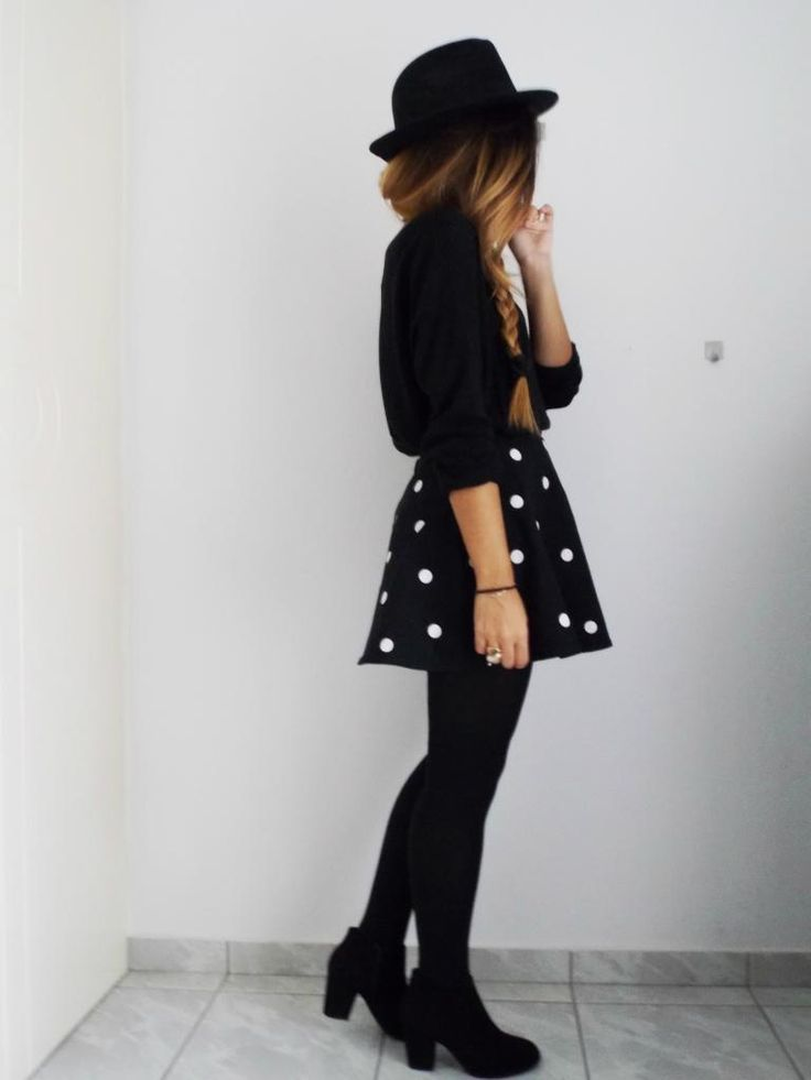black and white polka dot skirr | black long sleeved blouse | black hat | all…