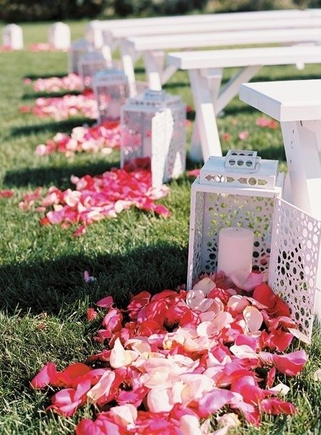 Love the idea of having the lantern open and the roses spilling out, instead of the traditional way of the roses marking the aisle.