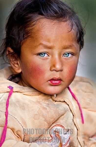 Portrait of a Nepali child with amazing eyes in the hills of East Nepal Himalaya