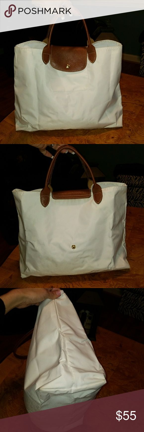 Longchamp Cabas Modele Depose White Bag Authentic Longchamp Cabas Models Depose White nylon. Pre owned with light general  Signs of use. It still has a lifetime of use left.  This bag measures H13, L16, D 6, strap is 5. Longchamp Bags Totes