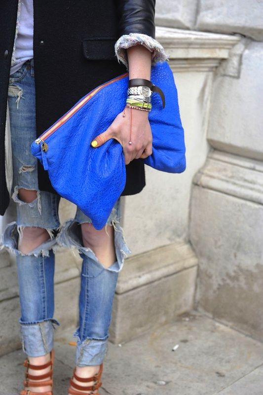 pre-fall transition. Oversized blue clutch / ripped denim.