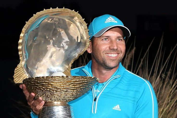 Sergio Garcia of Spain poses with his trophy after winning the final round of the Qatar Masters at the Doha Golf Club on January 25, 2014 in...