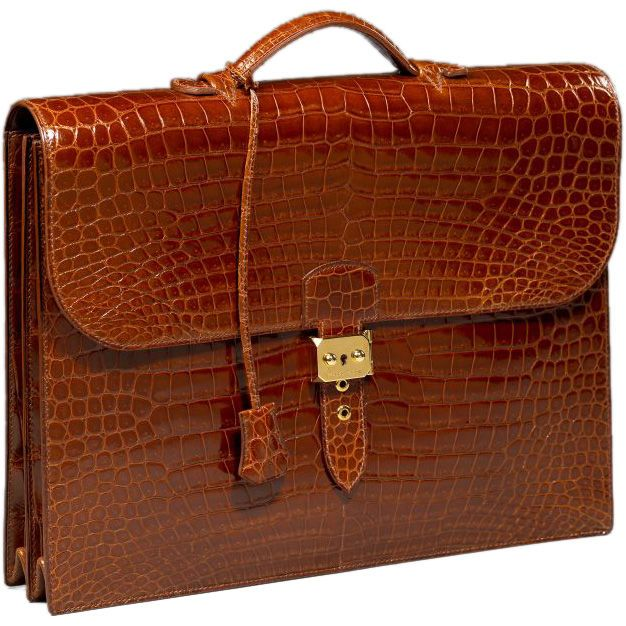 Hermès crocodile briefcase - yeah right.  He shall have NOTHING more expensive than I.