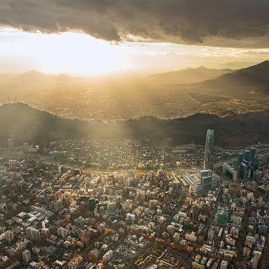 vista panorámica de santiago de chile con el sol que le deja en la mejor luz... Ají Hostel: Google+