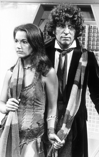 Tom Baker as the Fourth Doctor and Louise Jameson (Leela).  Pulling his scarf... naughty.