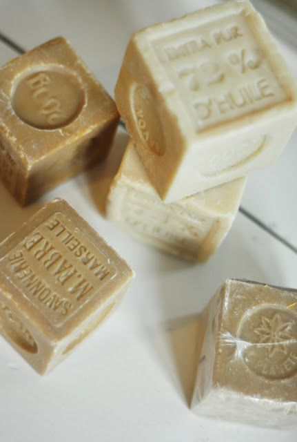 French Soaps . . .I use white, beige, cream and pale green ones in clear jars in the bathroom.  Even hotel soap can be used in this way, if they are attractive.