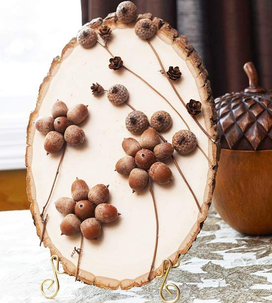 Earthy Wooden Plaque - With a purchased wood slice as the background, this autumn scene can be created in minutes. Hot-glue six twigs in place as shown, and finish the floral-inspired design with acorn parts and mini pinecones.