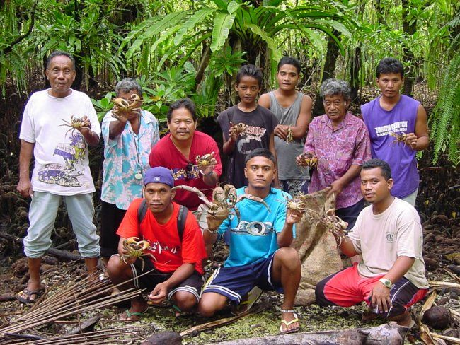 Marshall Island People Holding Up Their Crabs Oceania