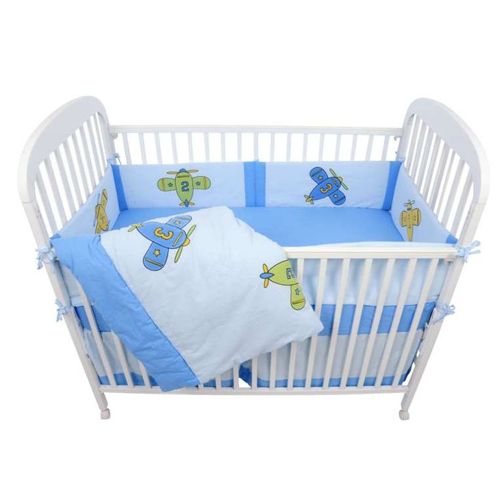 Baby bedding in shades of blue with airplanes.