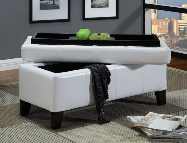 a luxurious feltlined storage ottoman with a wooden tray builtin to the