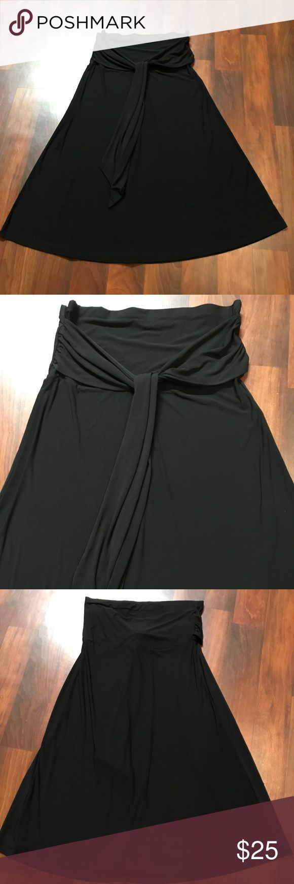 Lane Bryant Plus Size Black Maxi Skirt 18/20 Lane Bryant Plus Size Black Maxi Skirt 18/20  Plus Size Black Maxi Skirt with attached belt. Could be used as a bathing suit cover up too. Size 18/20 Brand Lane Bryant Fabric Polyster Spandex with stretch  Measurements Length: 43 inches Waist: 19 inches laying flat Hips: 20 inches laying flat  * Excellent condition with no sign of wear, tear, or stains. * Smoke Free Home * Pet Free Home * Daily Shipper * Save with bundle discount! * Open to…