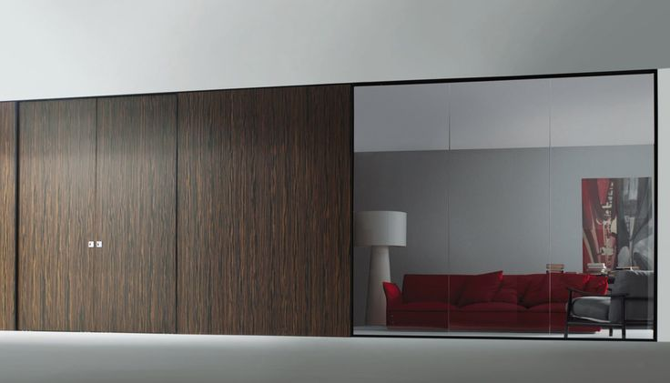 Movable Wall System with ebony sliding doors and glass panels