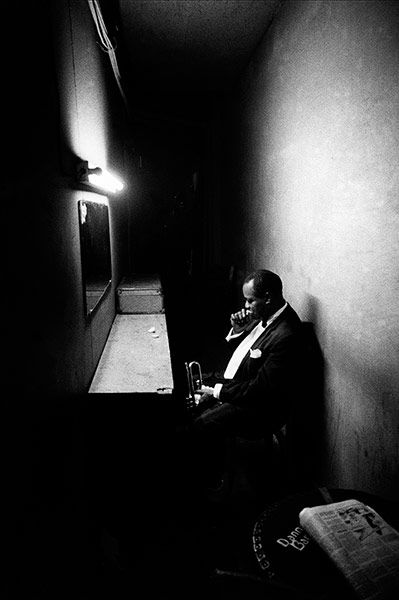 U.S.  Louis Armstrong's last moment of concentration in the wings before performing in Philadelphia in 1958 //  Dennis Stock/Magnum Photos