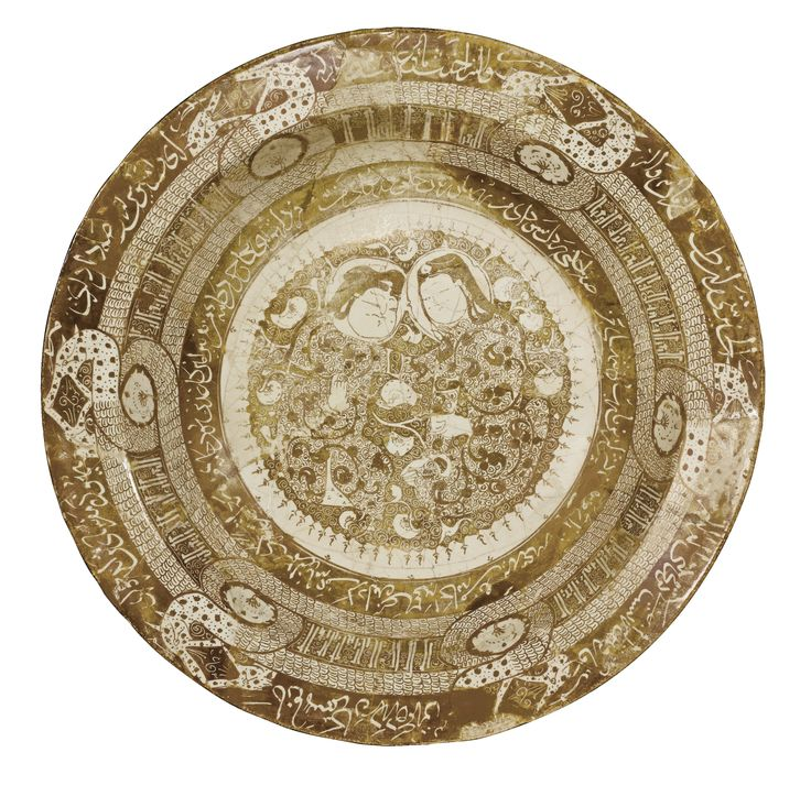 A KASHAN LUSTRE DISH WITH A SEATED COUPLE, INTERTWINED DRAGONS AND INSCRIPTIONS, PERSIA, EARLY 13TH CENTURY