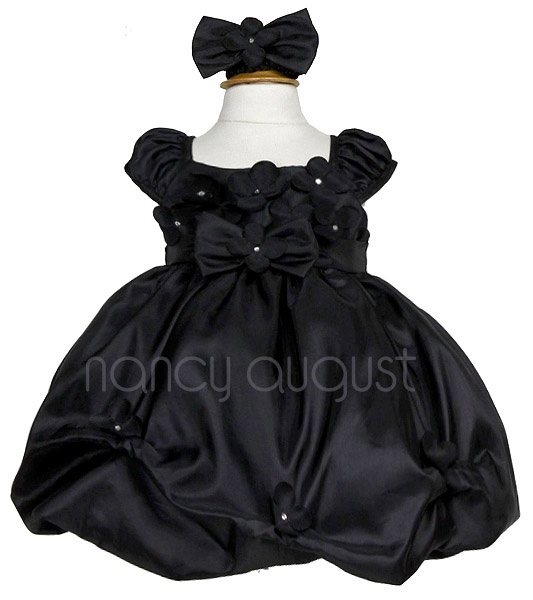 Black Baby Dress with Flower Bodice: This black baby dress features a light weight taffeta fabric with a unique flower garden displayed on the bodice. The bubble skirt is accented with a slight flower pick up style and has additional netting underneath for a full volume look. The center waistline is embellished with a elegant bow-tie finished with another lovely flower. This elegant black baby dress will make one little angel very happy on multiple occasions as it is very versatile.