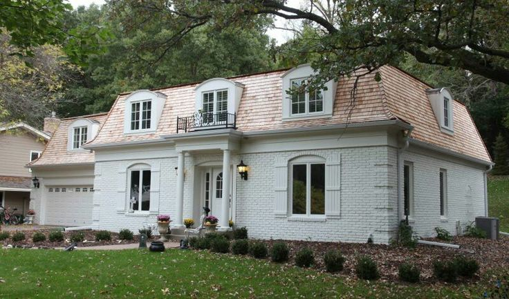 Mansard Roof: a roof that has four sloping sides, each of which becomes steeper halfway down.