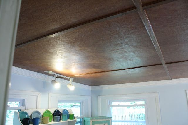 luan plywood ceiling - this would look good in his basement.