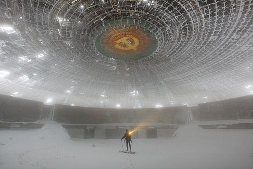 """Amazing story about an abandoned saucer-shaped building in snowy Bulgaria:    """"Today, this incredible derelict building stands as an iconic monument to an abandoned ideology."""""""