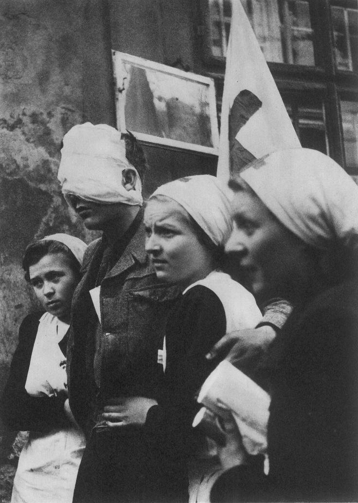 Wounded rebel with nurses. Prague uprising, May 1945.