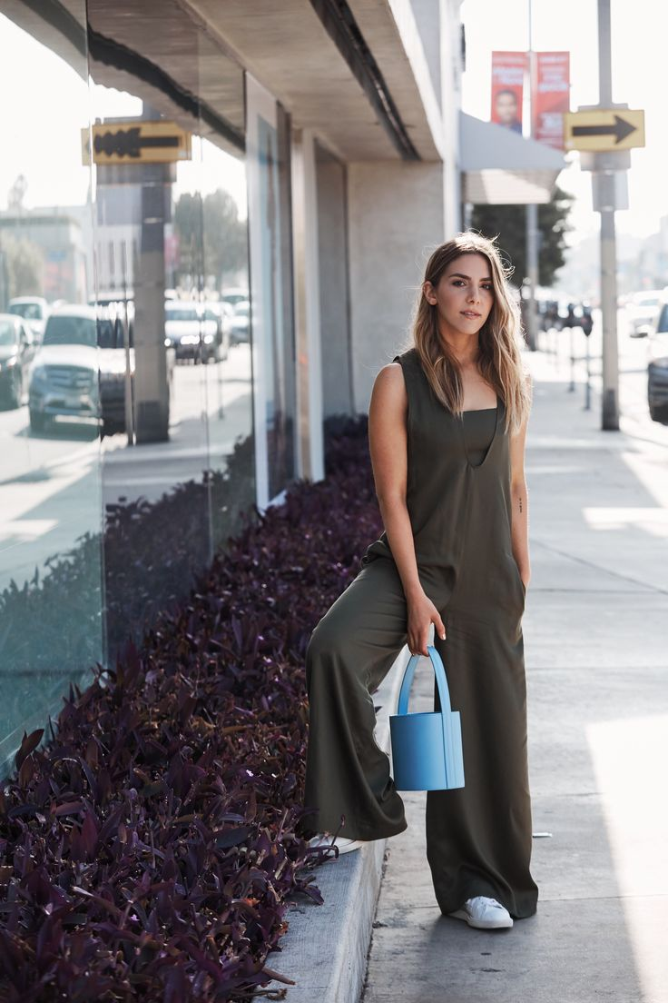 Erin Grey Style by the People Instagram approved outfit wearing opening ceremony neutral jumper and staud baby blue bucket bag and golden goose sneakers