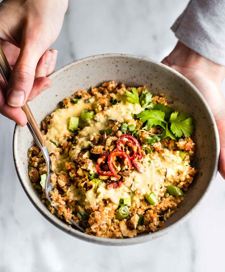 This Colorful Thai Cauliflower Rice Salad is packed full of flavor, spice, and made easy! Thai spiced mixed into a Carrot Cauliflower Rice Salad with Avocado Cream Dressing! It'sboth Paleo, Vegan, and made in under 30 minutes. Perfect as is or with a protein of choice. Simple, wholesome, healthy! Whole 30 friendly.
