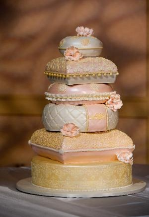 6 tier of opulance - this #wedding cake has it all with pillow shaped tiers, sugar flowers, hand piping, tufting, stenciling, gold and shade of pink and coral.  www.sweetcakesbyrebecca.com
