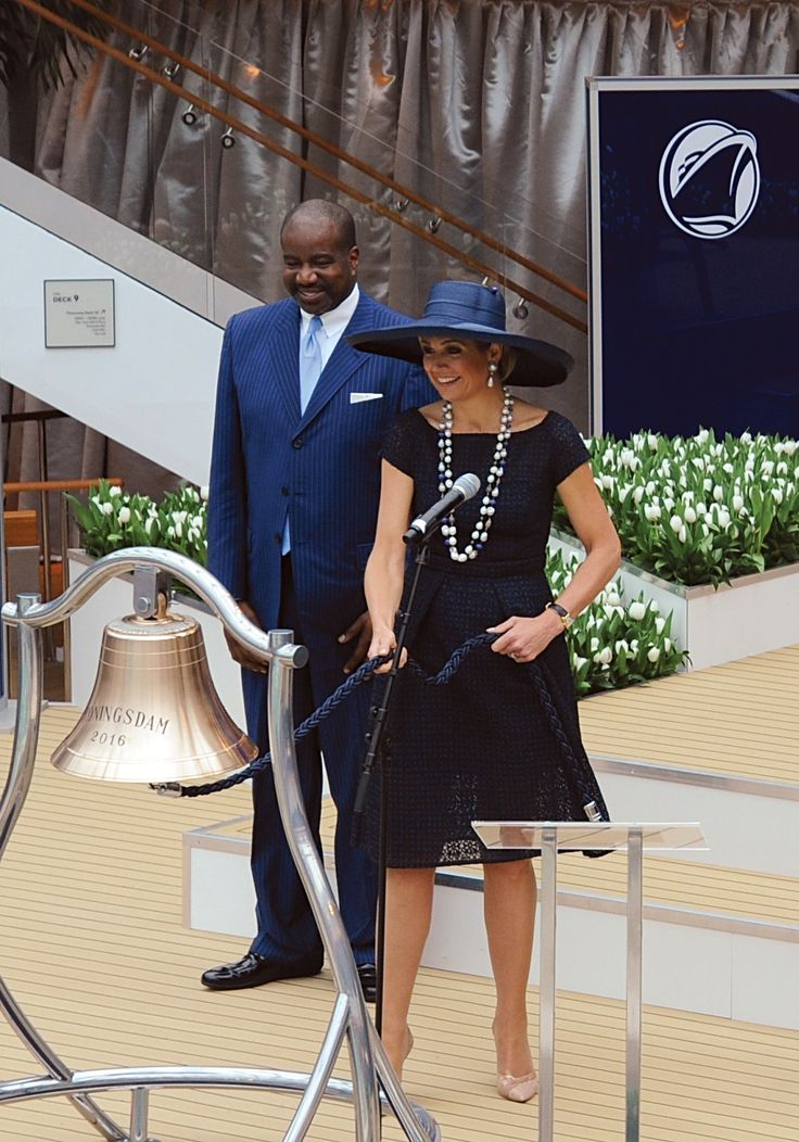 Caption     Her Majesty Queen Maxima of the Netherlands rings the bell of ms Koningsdam - the newest cruise ship for Carnival Corporation and one of its 10 brands, Holland America Line - after officially blessing the bell with a glass of champagne, with Orlando Ashford, president of Holland America Line, watching her do the honors. Source     Carnival Corporation & plc Media Contact    CONTACT: Carnival Corporation Media Contacts - Roger Frizzell, Carnival Corporation…