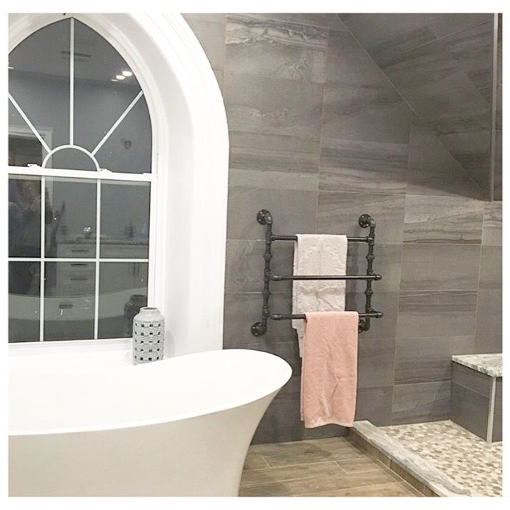 Such a dreamy space featuring our 3-tier towel rack.